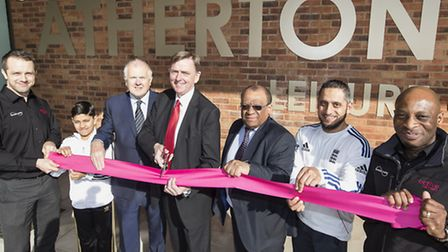 Mayor of Newham Sir Robin Wales, cutting the ribbon at the centre, together with Cllr Ken Clark, Cll
