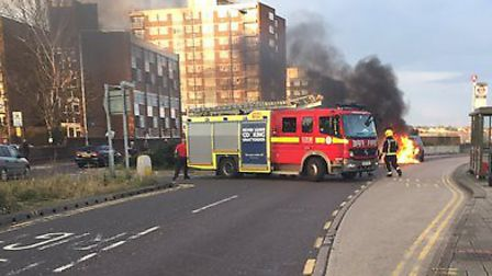 A car exploded into flames outside Wanstead Tube station yesterday evening. Photo: Nicholas Jones