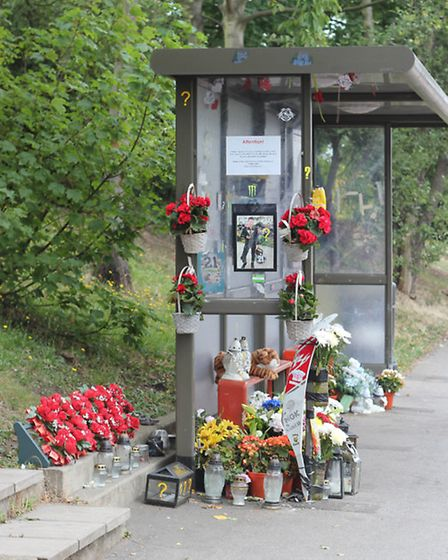 Floral tributes to Justas Pranckunas, 20, and Redas Dainys, 16, left in Woodford Avenue, Clayhall, l