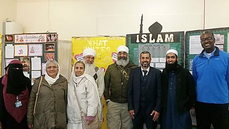Religious leaders and parents at the Quwwat ul Islam Girls school event