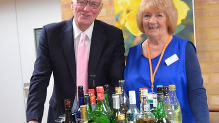 Barry Hearn with Saint Francis Hospice volunteer Beryl Scott and the mobile pub