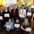 Volunteers and employers who worked on the Arc in the Park makeover with their certificates