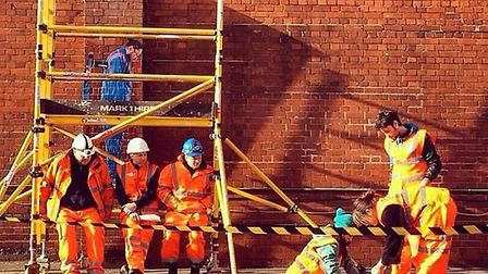 The team at work on the wall mural at Forest Gate station. Picture: Bifidoart/Instragram