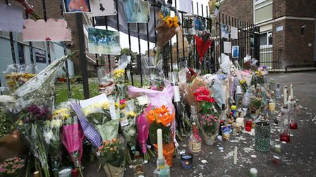 Floral tributes left at St Johns Estate in Pitfield Street where Detectives investigating the murde
