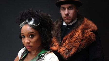 Keisha Atwell as The Greener and Dickon Gough as Coster