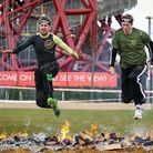 Recorder news editor Freddy Mayhew and reporter Mark Shales cross the final firey obstacle. Picture: