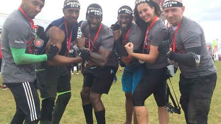 Dwayne Tapper, 37, from Hackney (second left) with friends after completing the Reebok Spartan Race