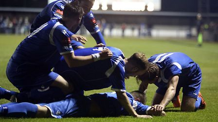 APRIL 30: Jake Reed (bottom)celebrates scoring Lowestoft's second during the Ryman Isthmian Premier League Play-Off Semi...
