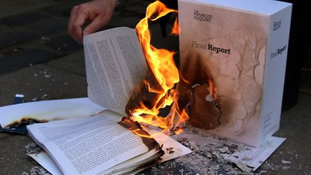 Campaigners burn a report at a previous protest about the contaminated blood scandal