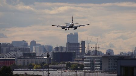 The ice sheared off of a plane making its final approach to land at City Airport in east London. Pic