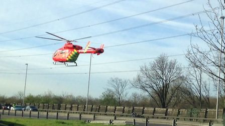 The London Air Ambulance landing next to the crash in the A406 near Redbridge roundabout.