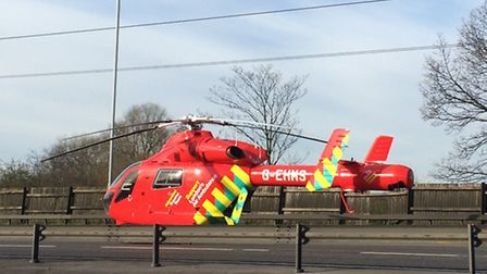 The Air Ambulance landing on the A406 to deal with a collision at around 8.20am this morning, near R