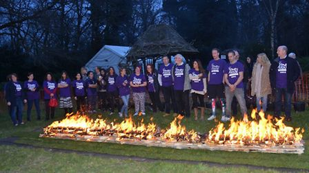 Fundraisers lining up to walk across a fire pit for a children's hospice. Photo: Aastha Gill/Havens