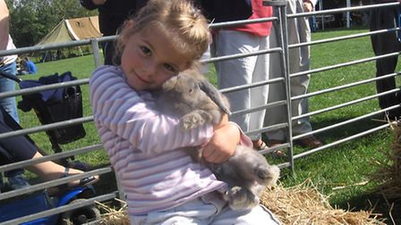 Little girl clutching a bunny