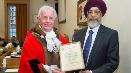 Mayor of Havering, Brian Eagling, awarded Dr Gurdev Saini, CCG clinical director with a civic award