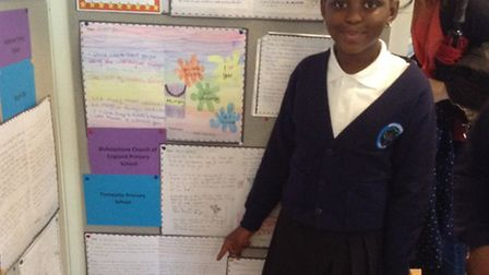 Rashida Sillah, 9, pointing to her 'thank you' letter at the University of Birmingham. Photo: Verity