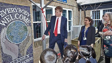 East Ham MP, Stephen Timms, unveiling the new community mosaic at Essex Primary School