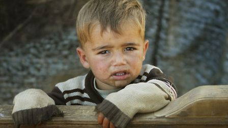 A child refugee in the makeshift settlement