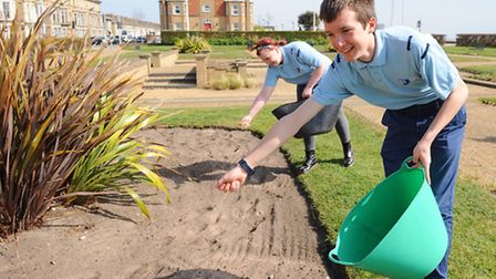 Police cadets sowing poppy seeds in the flower beds on Wellington gardens in Lowestoft.Jed Levett so