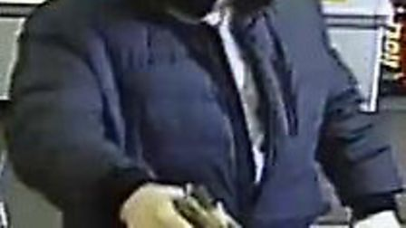 A CCTV still of Arvydas Filipavicius during one of his armed robberies