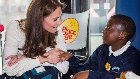 A pupil from Curwen Primary School greets the Duchess of Cambridge.