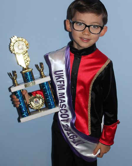 Thomas Vincent, 7, was competing in a group of 11 girls and is the first male competitor to win the