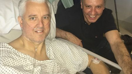 David Babbs with friend Chris Creevy in hospital after the attack