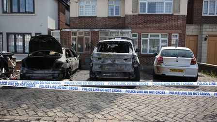 Three cars set on fire outside a house on Lord Avenue in Clayhall