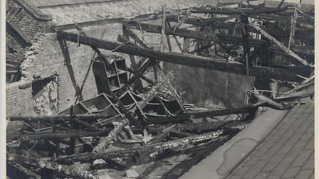 Fire bomb damage in the plate stockroom looking east, september 1940. Copyright Redbridge Borough Co