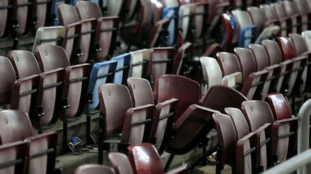 Damaged seats after the Barclays Premier League match at Upton Park, London.