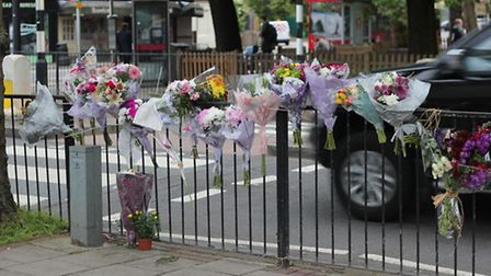 Floral tributes left in High Street, Wanstead, after Basant Lal Sharma, 91, was hit by a car and die