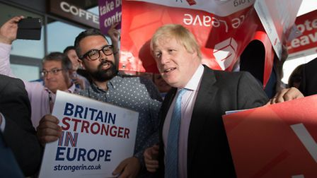 Boris Johnson (centre) meets both Vote Leave and Britain Stronger In Europe supporters in Ipswich, w