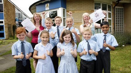Pupils and staff celebrate with their award winning letters. Photo: Sandra Rowse