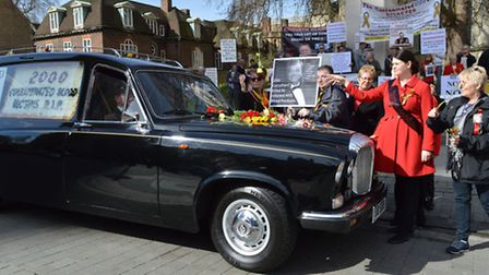 A hearse circled Parliament at the demonstration to commemorate the 2,000 who have so far died from