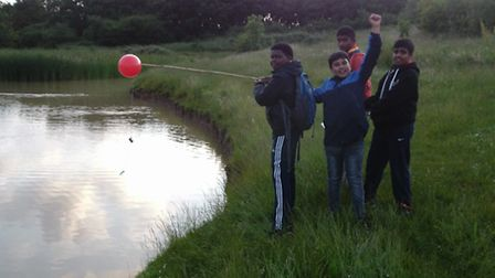 Ilford scouts enjoying a hike and fishing around Claybury Woods