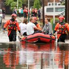 A family are rescued from a flooded property in Frinton Road Romford by London Fire Brigade water re