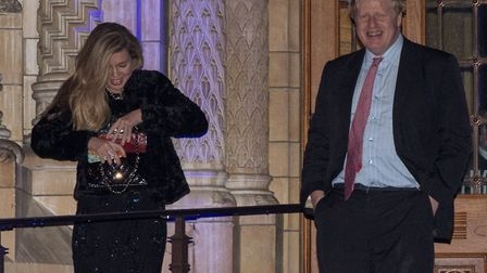 Then foreign secretary Boris Johnson passes Carrie Symonds as he leaves the Conservative party Black