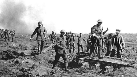 German prisoners help to carry British wounded back to their trenches after an attack by XIV (Irish)