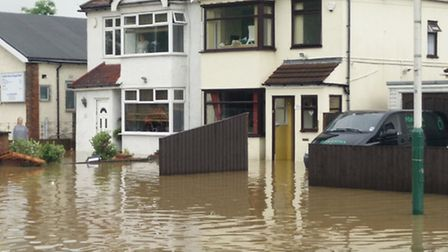 Flooded houses on Collier Row Lane (@ChrisCockram)