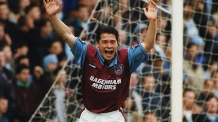 Tony Cottee celebrates a goal for West Ham