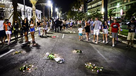 Tributes are placed over the blood stained road where bodies fell on the Promenade des Anglais, Nice