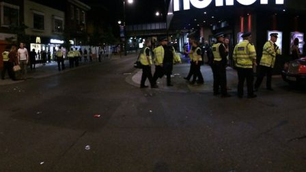 Officers line South Street as they prepare for revellers to leave Fiction nightclub