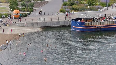Picture taken by Royal Victoria Docks resident of people swimming in the Royal Docks, which official