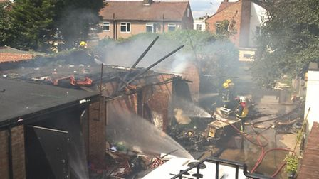 A range of single storey garages were destroyed by a fire in Rush Green this afternoon