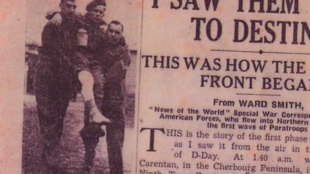 """The front page of the then News of the World showcasing the first D-Day wave, with """"A wounded Britis"""