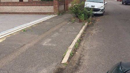 The parking bay in Calbourne Avenue with the faded parking bay lines.
