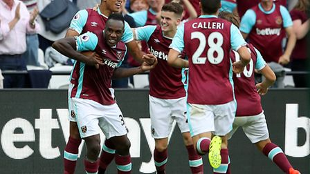 West Ham's Michail Antonio (left) celebrates scoring his sides first goal of the match during the Pr