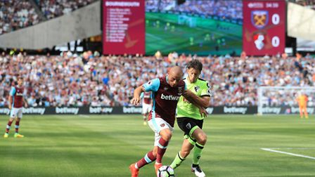 West Ham United's Gokhan Tore left) and AFC Bournemouth's Harry Arter battle for the ball