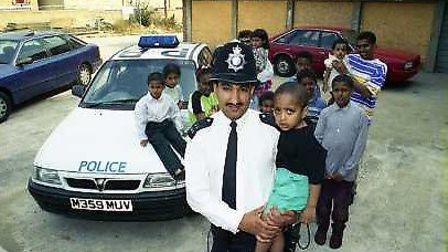 Pc Mohammed Mahroof with the Somalian refugees he worked closely with.