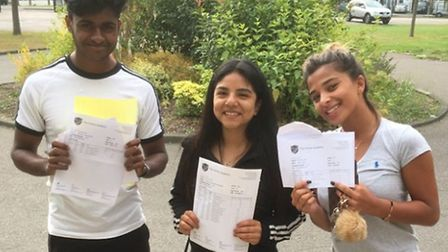 Students celebrating their A-level results at The Forest Academy, in Hainault.
